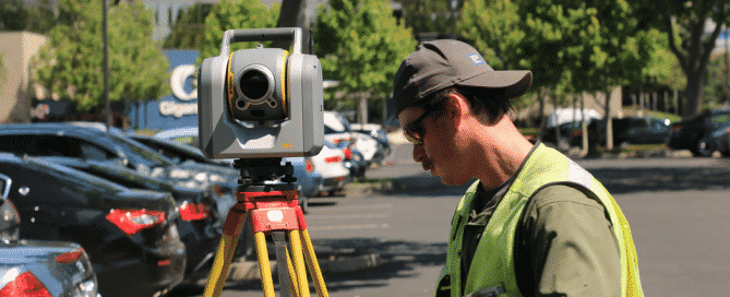 man using survey equipment