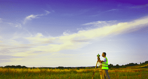 A technician conducting a land survey